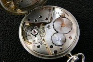 The inside of an Omega pocket watch.
