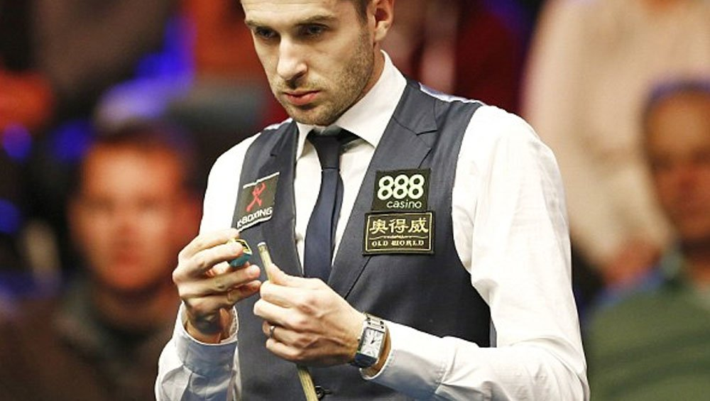 Mark Selby watches snooker