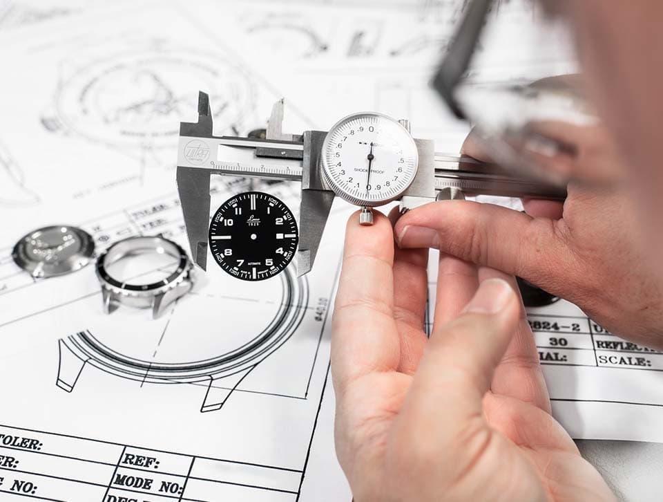a person measuring dial